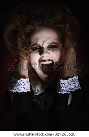 Closeup portrait of a scared screaming young girl  - stock photo