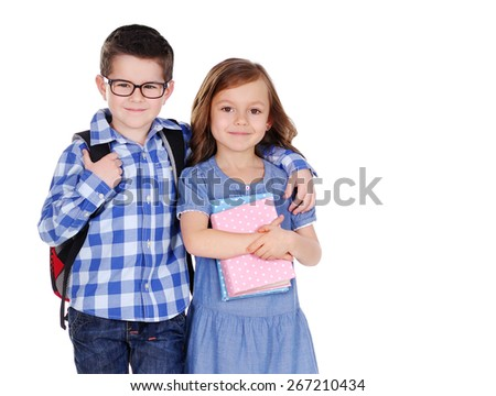 closeup portrait of a schoolboy and the schoolgirl - stock photo