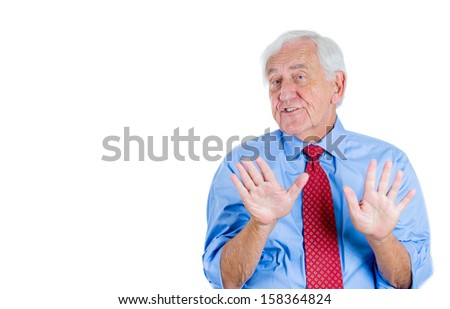 Closeup portrait of a senior executive, elderly businessman, grandpa trying to prove his point, denying the accusation, trying to calm down the opponent. Human conflict resolution, communication - stock photo