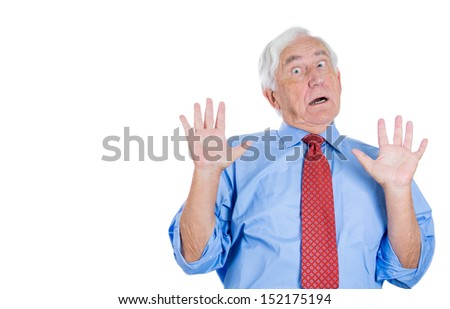 Closeup portrait of a senior executive man with hands up, surprised, shocked, scared, , isolated on white background. Bad unexpected news or unpleasant conversation. Conflict situation. - stock photo