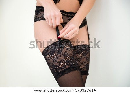 Closeup portrait of a sexy female hips in stockings isolated on a white background - stock photo