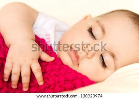 Closeup portrait of a sleeping baby girl - stock photo