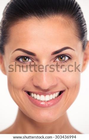 Closeup portrait of a smiling attractive woman looking at camaera - stock photo