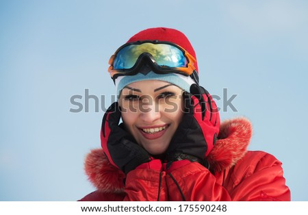 Closeup portrait of a smiling girl wearing ski glasses - stock photo
