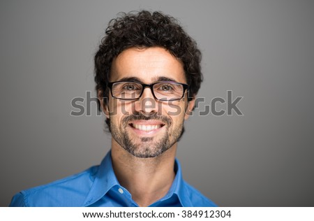 Closeup portrait of a smiling man. - stock photo