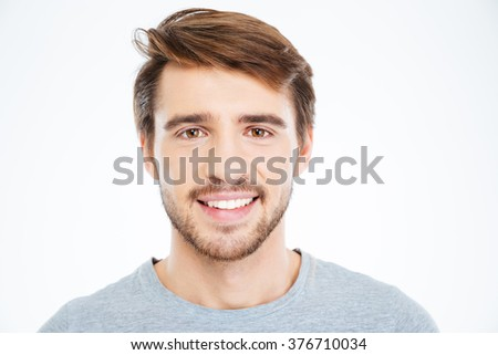 Closeup portrait of a smiling man looking at camera isolated on a white background - stock photo