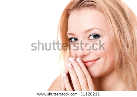 Closeup portrait of a smiling young blonde. Isolated