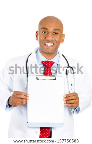 Closeup portrait of a smiling young male doctor holding a chart with blank copy space for advertisement, isolated on a white background. Doctors office visit, patient consent, health medical record.