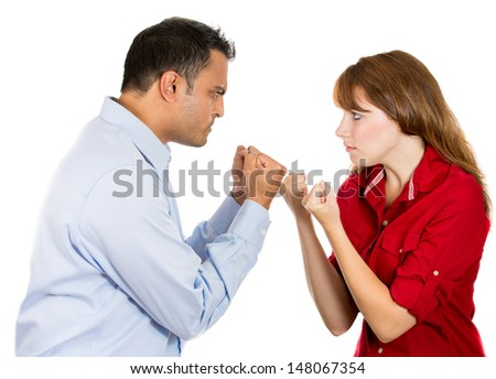 Closeup portrait of a stressed, arguing couple going through hard times in their relationship, boxing face to face isolated on a white background.