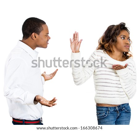 Closeup portrait of a stressed couple going through hard times in their relationship, isolated white background . Young man trying to explain something to woman, she puts hand up to face not listening - stock photo