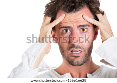 Closeup portrait of a stressed, depressed, alone, disappointed man having a headache running out of options in his life,  isolated on white background. Human emotions and facial expressions. - stock photo