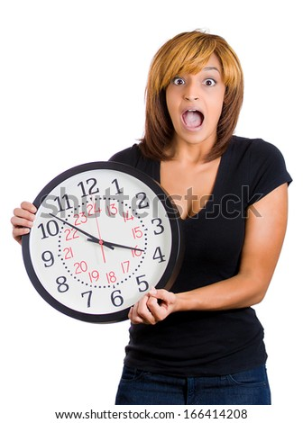 Closeup portrait of a stressed woman holding, looking anxiously at a clock, pressured by lack of time, running out, isolated on a white background. Negative facial expression emotion feelings - stock photo
