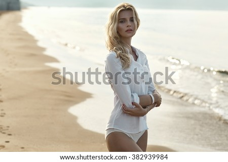 Closeup portrait of a tanned blond lady in tropics - stock photo