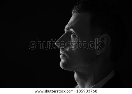 Closeup portrait of a thoughtful man. Black and white photo.  - stock photo