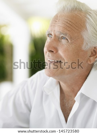 Closeup portrait of a thoughtful mature man looking up - stock photo