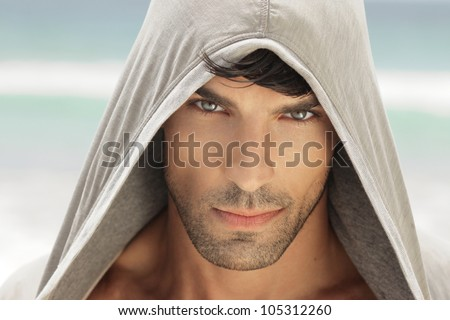 Closeup portrait of a very handsome young man with high detail and nice eyes - stock photo
