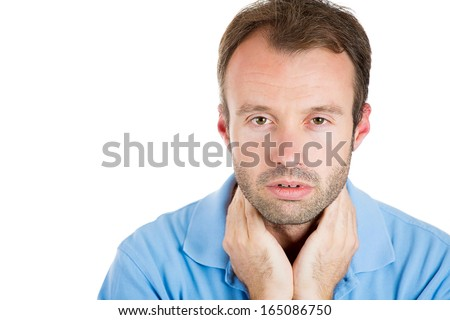 Closeup portrait of a very sad, depressed, alone, disappointed gloomy man looking downcast with hands behind neck, isolated on white background space to left. Negative human emotion facial expression - stock photo