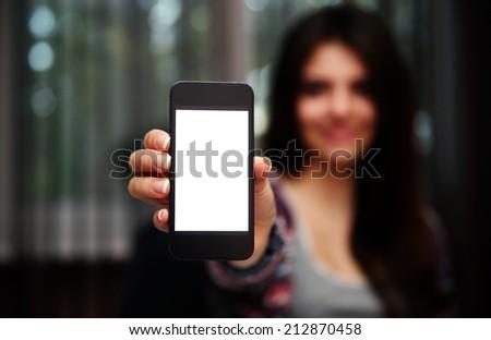 Closeup portrait of a woman showing smartphone screen - stock photo