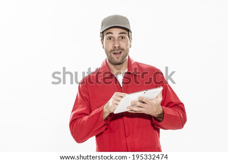 closeup portrait of a workman with expressive face using digital tablet - stock photo