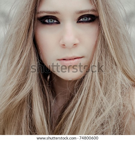 Closeup portrait of a  young beautiful girl with smoky eye makeup - stock photo