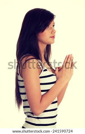 Closeup portrait of a young caucasian woman praying - stock photo