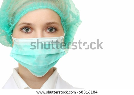 Closeup portrait of a young doctor wearing a mask isolated on white background