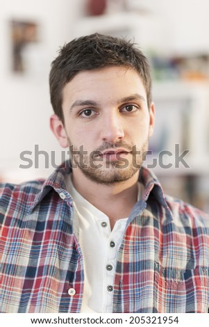 closeup portrait of a young man - stock photo