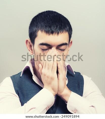 Closeup portrait of a young man praying to god - stock photo