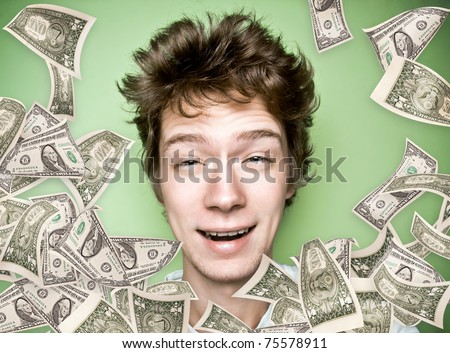 Closeup portrait of a young man with money rain