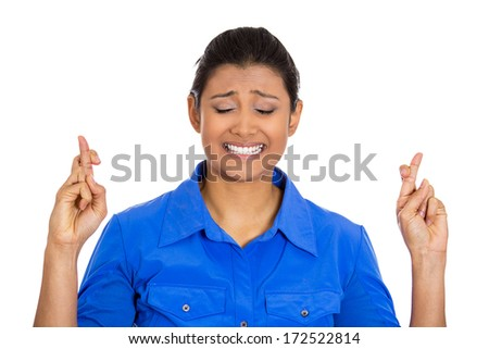 Closeup portrait of a young pretty woman crossing fingers wishing and praying for miracle, hoping for the best, isolated on white background. Positive emotion facial expression feelings attitude - stock photo