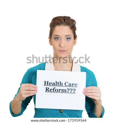 Closeup portrait of a young serious woman holding a sign healthcare reform, thinking about universal health care coverage issues, isolated on a white background. politics, government , legislation