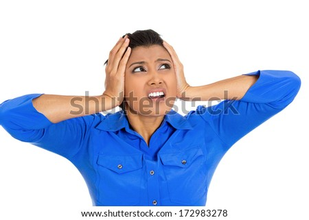 Closeup portrait of a young unhappy stressed woman covering closed ears looking upwards to say stop making that loud noise it's giving me a headache, isolated on white background. Negative emotion - stock photo