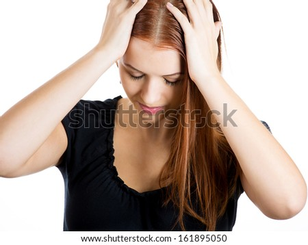 Closeup portrait of a young woman, unhappy student, female worker, holding hair on head very upset and sad, depressed and lost, isolated on white background. Human emotions and facial expressions - stock photo