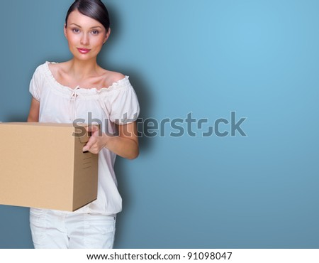 Closeup portrait of a young woman with box - stock photo