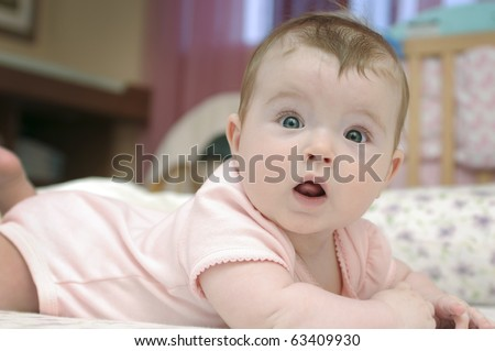 Closeup portrait of adorable baby girl looking at camera - stock photo