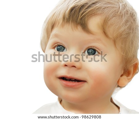 Closeup portrait of adorable baby looking with great interest