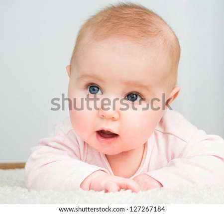 closeup portrait of adorable baby over white - stock photo