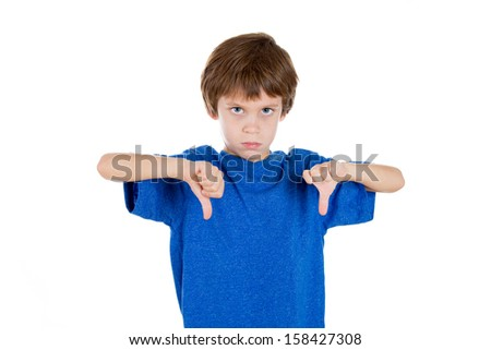 Closeup portrait of adorable child giving two thumbs down sign gesture, isolated on white background - stock photo