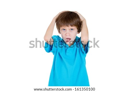 Closeup portrait of adorable kid stressed with headache, hands on head, does not want to listen to you isolated on white background with copy space - stock photo