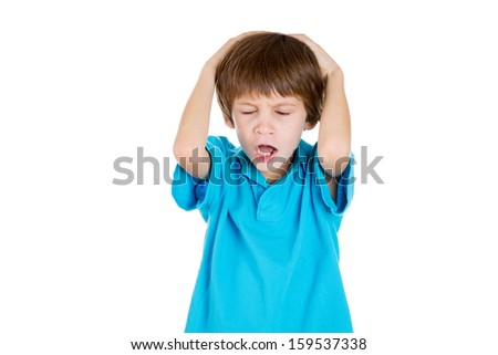 Closeup portrait of adorable kid stressed with headache, hands on head, doesn't want to listen to you isolated on white background with copy space - stock photo