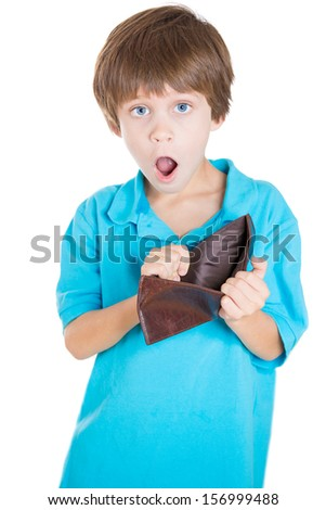 Closeup portrait of adorable young boy holding empty wallet showing no money and surprised by it, isolated on white background - stock photo