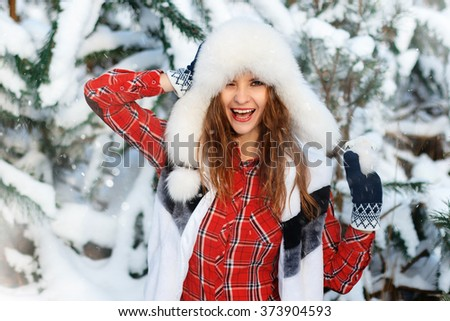 Closeup portrait of agirl in snow forest