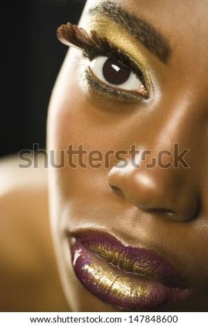 Closeup portrait of an African American woman with highfashion makeup - stock photo