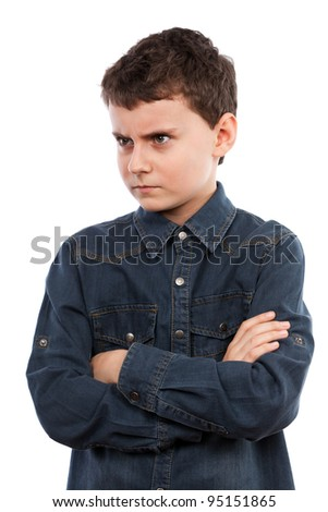 Closeup portrait of an angry boy with his arms folded