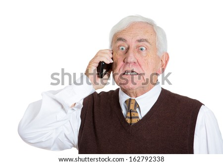 Closeup portrait of an annoyed, angry elderly businessman talking on his cellular, having unpleasant conversation looking pissed off, isolated on a white background. Human emotions, facial expressions - stock photo