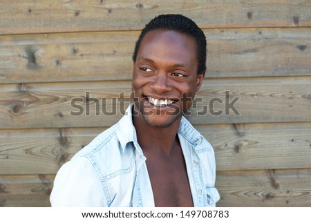 Closeup portrait of an attractive black man with happy expression