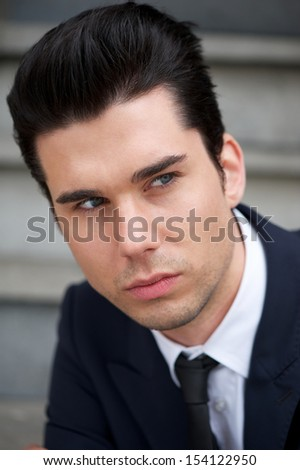 Closeup portrait of an attractive male business person - stock photo
