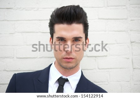 Closeup portrait of an attractive young man in business suit - stock photo
