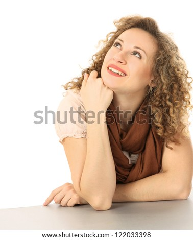 Closeup portrait of an attractive young woman sitting at the desk