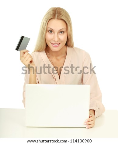 Closeup portrait of an attractive young woman with a laptop sitting at the desk